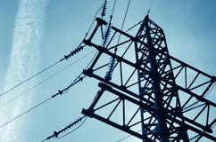 Electricity pylon with insulators and power lines Royalty Free Stock Image