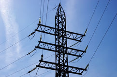 Electricity pylon with insulators and power lines Royalty Free Stock Images