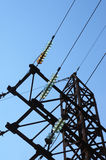 Electricity pylon with insulators and power lines Stock Images