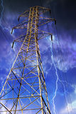Electricity Pylon with Lightning in Background. Royalty Free Stock Photos