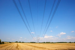 Electricity pylon and lines in countryside Royalty Free Stock Images
