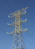 Electricity Pylon in Mexico. With three spars and a support spar against blue sky Royalty Free Stock Photo
