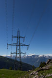 Electricity pylon in the mountains with blue sky Stock Image