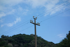 Electricity pylon. In the mountains with the sky in the background Stock Photography