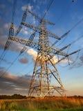 Electricity pylon near Zapy village, Czech Republic. Electricity pylon at sunset near Zapy village, Czech Republic Stock Image