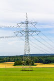 Electricity pylon with power cables Stock Photos