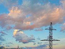Electricity Pylon - power line transmission tower of the sunset. Beautiful cloudy sky Royalty Free Stock Photography