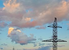Electricity Pylon - power line transmission tower of the sunset. Beautiful cloudy sky Royalty Free Stock Photo