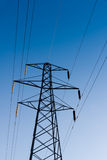 Electricity Pylon and Power Lines. On Blue Sky Background, vertical, Kent , England Royalty Free Stock Images