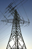 Electricity pylon and power lines. Low angle view of an electricity pylon and power lines Royalty Free Stock Photo