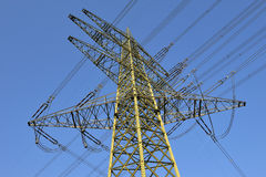 Electricity pylon and power lines. Low angle view of an electricity pylon and power lines Royalty Free Stock Images