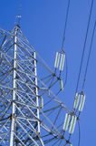 Electricity Pylon. And Power Lines on Blue Sky Background Royalty Free Stock Photo