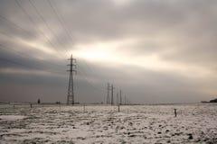 Electricity pylon. S in a snow landscape Stock Photo