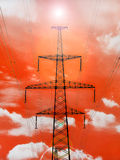 Electricity pylon with shine on red background. Stock Image