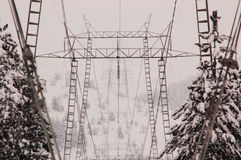 Electricity pylon shrouded in winter. A massive steel electricity pylon stand in a foggy winter Royalty Free Stock Images