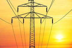 Electricity pylon. Silhouette of the electricity pylon at the sunrise Stock Photo