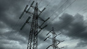 Electricity pylon with stormy sky. On the background. Electrical pylons with timelapse clouds. 4K stock footage
