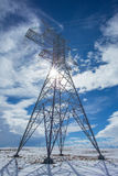 Electricity Pylon with Sun Stock Photography