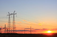 Electricity pylon on sunrise Royalty Free Stock Photos