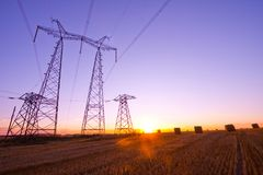 Electricity pylon on sunrise Royalty Free Stock Images