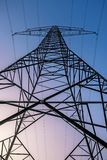 Electricity pylon at sunrise in front of blue pink sky stock photos