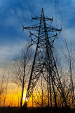 Electricity pylon at sunset Royalty Free Stock Photography