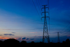 Electricity pylon at sunset Royalty Free Stock Images