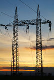 Electricity pylon on sunset Stock Photos