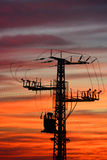 Electricity pylon at sunset Royalty Free Stock Photos