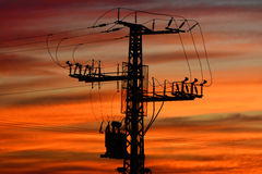 Electricity pylon at sunset Stock Image