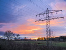 Electricity pylon. At sunset with evening sky Stock Images