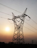 Electricity pylon in sunset Royalty Free Stock Photo
