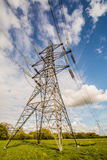 Electricity Pylon. In the UK with blue sky and clouds royalty free stock photos