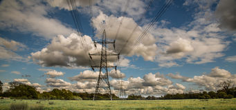 Electricity Pylon. In the UK with blue sky and clouds Royalty Free Stock Images