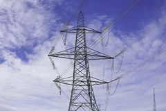 Electricity pylon. On Uk countryside.Blue sky with clouds in background.Energy production and transportation.British Northern powerhouse stock image