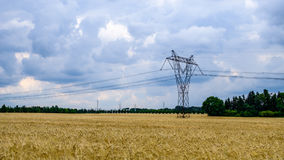 Electricity Pylon under the clouds Stock Images
