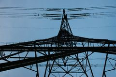 An Electricity Pylon Viewed From Below Looking Towards The Sky stock photography
