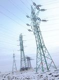Electricity pylon in  winter Royalty Free Stock Photo