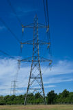 Electricity Pylons. Two Electricity Pylons Carrying National Grid Power Cables Stock Photo