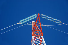 Electricity pylons. High voltage electricity pylon against blue sky Royalty Free Stock Photos