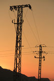 Electricity Pylons. In the morning at sunrise Royalty Free Stock Images