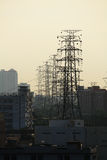 Electricity pylons. And lines in the city Stock Image