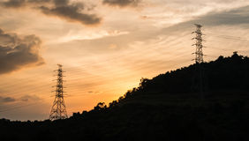 Electricity pylons. On a hill Royalty Free Stock Photos