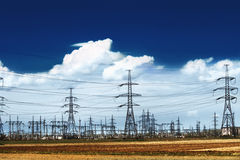 Electricity pylons. With a blue sky Stock Photo