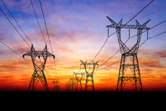 Electricity pylons. At orange sunset Royalty Free Stock Images