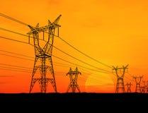 Electricity pylons. At orange sunset Stock Photos