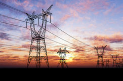 Electricity pylons. At orange sunset Stock Photography