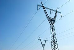 Electricity pylons. On background of the blue sky Stock Photo