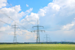 Electricity pylons. High voltage electricity pylons and sky landscape Royalty Free Stock Photos