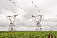 Electricity pylons against a stormy sky Royalty Free Stock Image